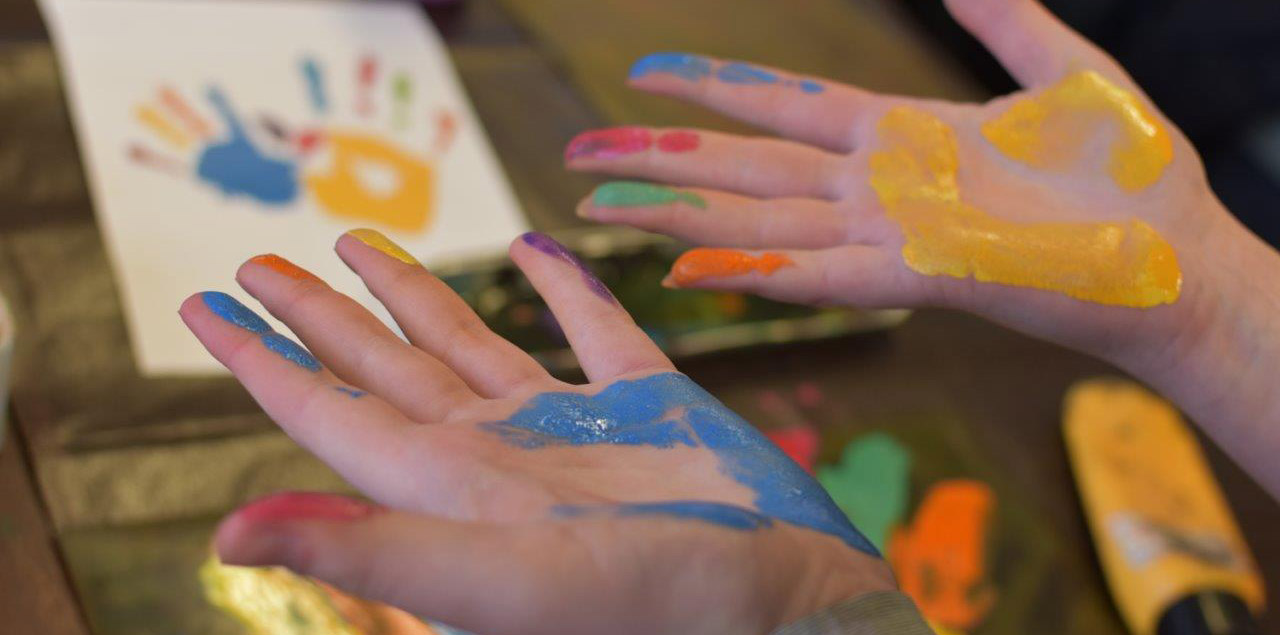 Image of hands covered in paint